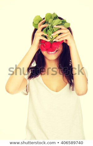 beautiful brunette eats radish stock photo © cboswell