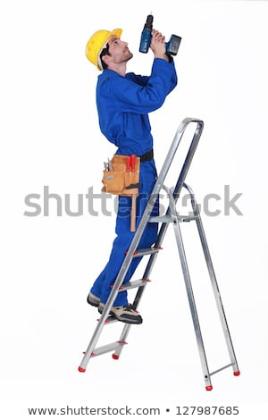 Laborer with drill on a ladder Stock photo © photography33