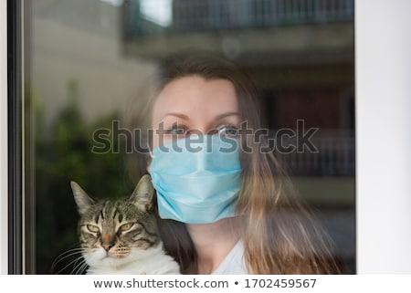 bakıyor · arkasında · maske · fotoğraf · genç · kadın - stok fotoğraf © Steevy84
