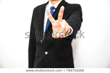 Man giving peace or victory sign stock photo © elenaphoto