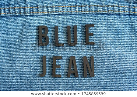 Jeans word with jeans texture over white background Stock photo © ozaiachin