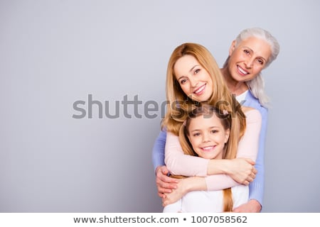 Rubio madre hija posando sonriendo familia Foto stock © luminastock