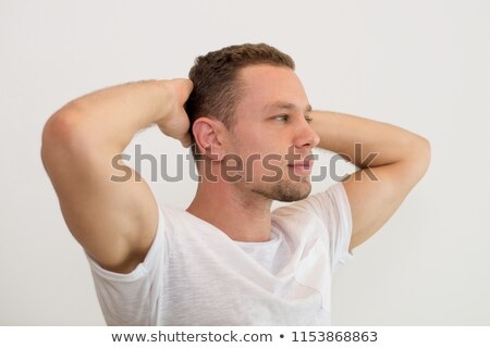 casual man with both hands behind head looks away Stock photo © feedough
