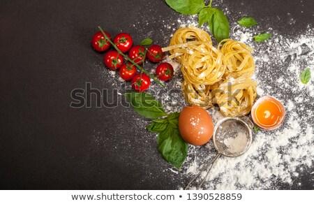 Italian pasta fettuccine nest  and cherry tomato  Stock photo © natika