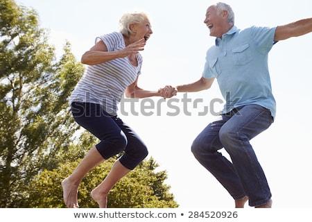 Casal de idosos saltando ar mulher céu primavera Foto stock © monkey_business