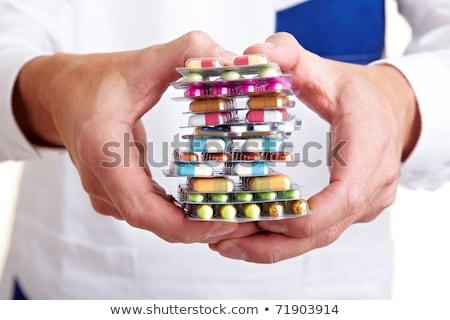 mulher · pílulas · retrato · verde · olhos - foto stock © hasloo