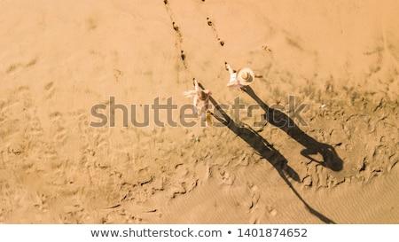 lábnyomok · nedves · homok · tengerpart · nyom · napos · idő - stock fotó © bmonteny