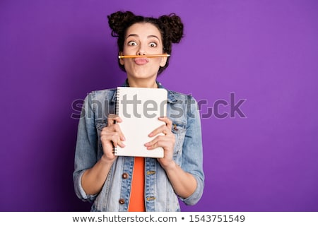 Girl in jeans on a bright background with notes Stock photo © pugovica88