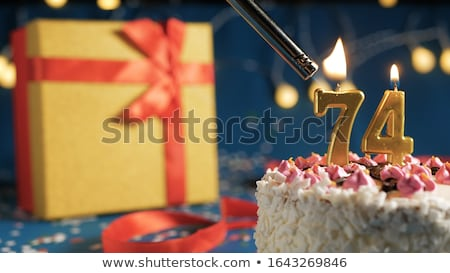 Birthday cake with burning candle number 74 Stock photo © Zerbor