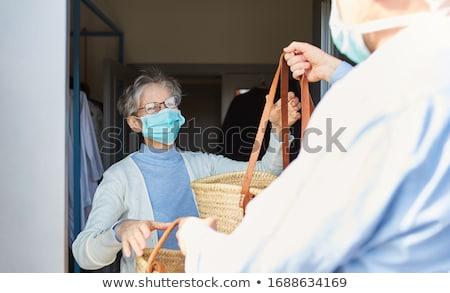 Helpen hulp opknoping handschoen fles zand Stockfoto © tilo