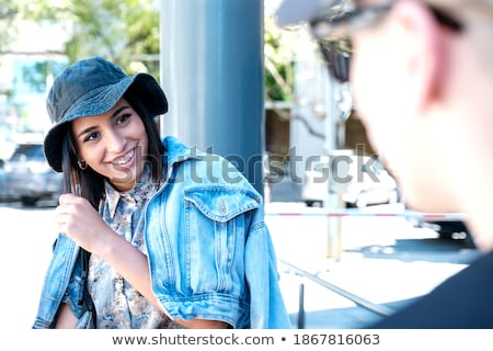 latin woman in black jacket and hat stock photo © lubavnel