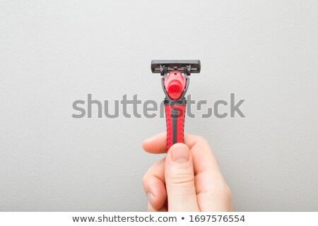 Fiatalember tart borotva kéz arc férfi Stock fotó © Valeriy
