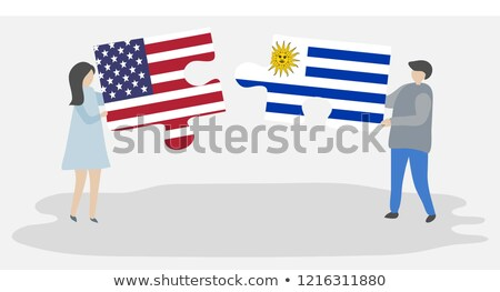 Stock photo: USA and Uruguay Flags in puzzle