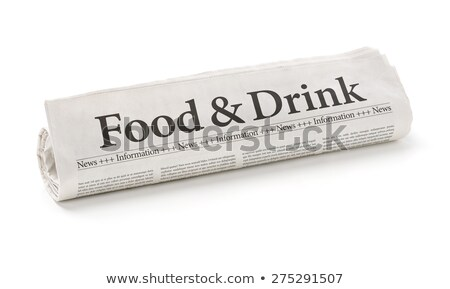Rolled newspaper with the headline Food and Drink Stock photo © Zerbor