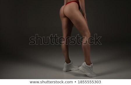 closeup portrait of a fitness female buttocks stock photo © deandrobot