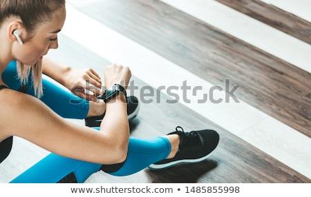 Vrouw naar horloge aantrekkelijke vrouw geïsoleerd witte Stockfoto © deandrobot