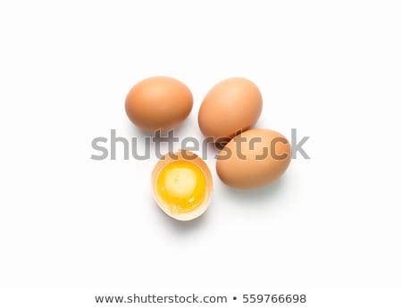 broken egg on white background Stock photo © artfotoss