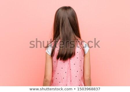 Vonzó lány külső hátrafelé fiatal gyönyörű divatos Stock fotó © Aikon