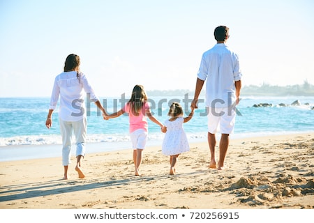 father and daughter on the beach sand together stock photo © lunamarina