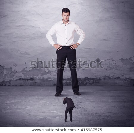 Business man looking angry on little man Stock photo © fuzzbones0