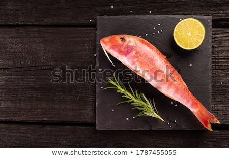 Whole red mullet wooden background Stock photo © marimorena