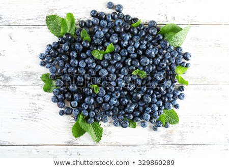 Tasty ripe blueberry pile on wooden table Stock photo © stevanovicigor