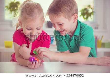Iki kızlar oynamak tablo oyuncaklar kız Stok fotoğraf © superelaks