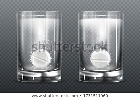 Aspirina comprimido vidro água branco médico Foto stock © OleksandrO