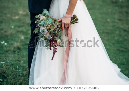 The groom with a bouquet of wildflowers Stock photo © O_Lypa