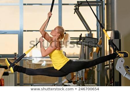 Sportos lány nyújtás tornaterem ajkak akasztás Stock fotó © bezikus