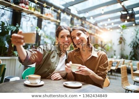 Сток-фото: привлекательный · сидят · питьевой · кофе · фотография