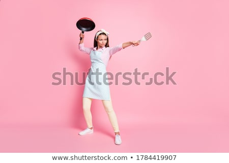 crazy beauty brunette housewife on kitchen cooking Stock photo © iordani