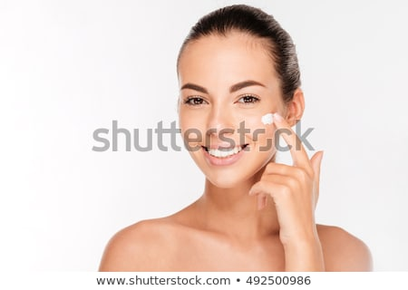 Young woman preparing for facial treatment isolated on white Stock photo © Elnur