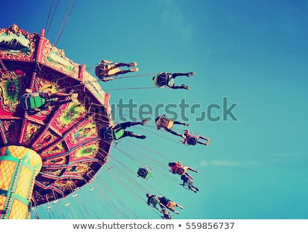 Children playing on rides in amusement park Stock photo © bluering