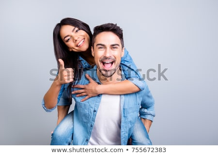 woman with hands up on the back of her boyfriend  Stock photo © feedough