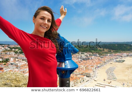 Beautiful woman using coin paid binoculars on high hill and look Stock photo © vlad_star