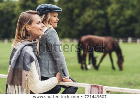 mother and daughter at paddock with horse stock photo © lightfieldstudios