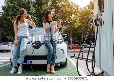 Jeune femme séance voiture électrique femme Voyage amusement Photo stock © IS2