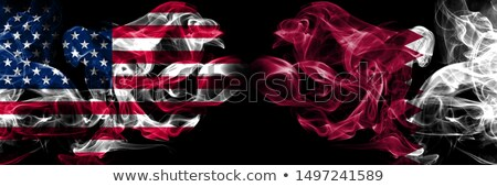 Football in flames with flag of qatar Stock photo © MikhailMishchenko