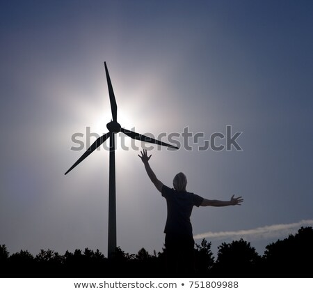 man raising arms at sun and Wind Turbine Stock photo © IS2