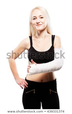 fitness girl with a broken arm stock photo © kokimk