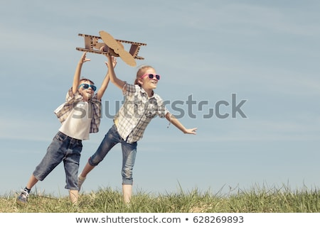 two sisters playing outdoors and smiling stock photo © monkey_business