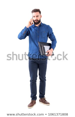 Upset businessman holding a phone at arms length Stock photo © Giulio_Fornasar