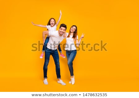 Back view of a cheery family with a little daughter Stock photo © deandrobot