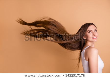 Smiling girl?s hair blowing in wind Stock photo © IS2