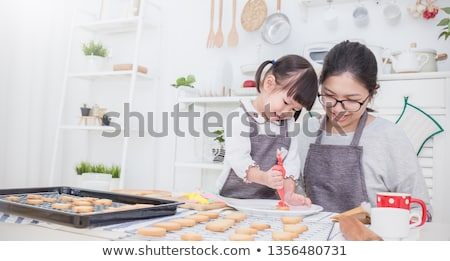 Toddler girl baking with mother Stock photo © IS2