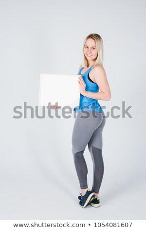 Sport fitness woman hold blank board Stock photo © hsfelix