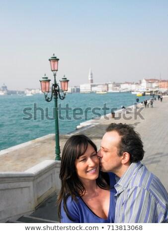 Portrait of kissing couple near lagoon Stock photo © IS2