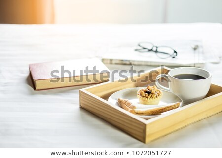 morning coffee bread and book or newspaper on the bed stock photo © snowing
