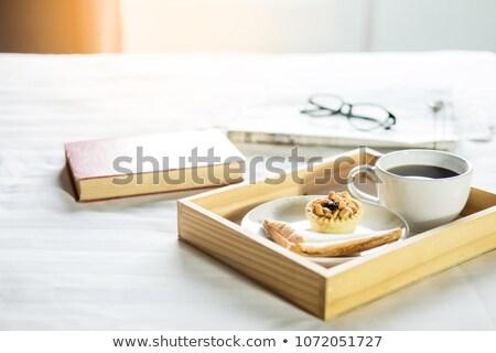 Manhã café pão livro jornal cama Foto stock © snowing